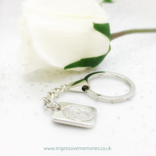 small dog tag fingerprint charm on keyring