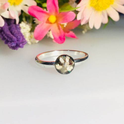 Silver ring with cremation ashes