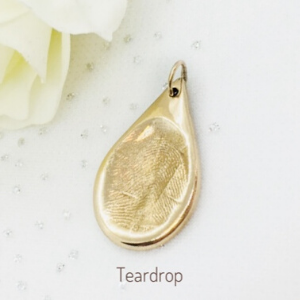 golden fingerprint charm