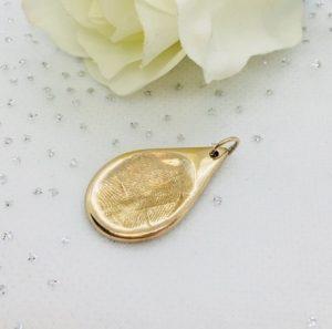 golden fingerprint charm