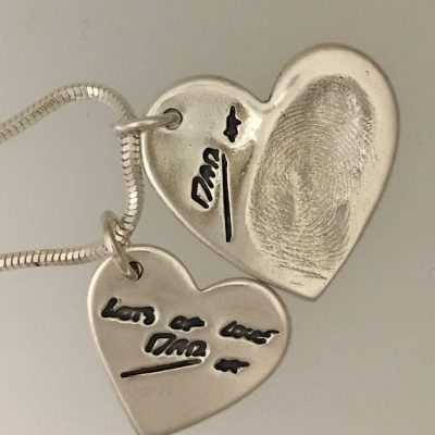 hand writing signature in silver