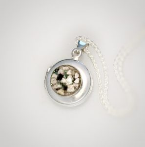 external set silver locket with cremation ashes
