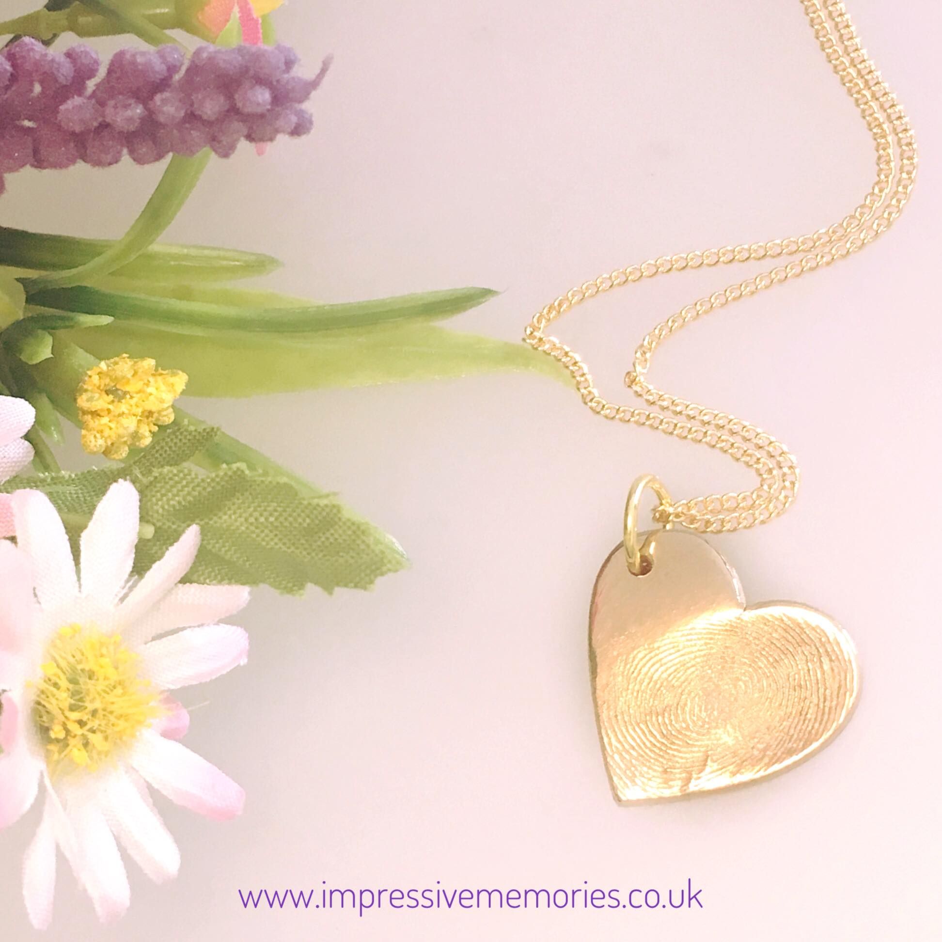 golden fingerprint charm with necklace