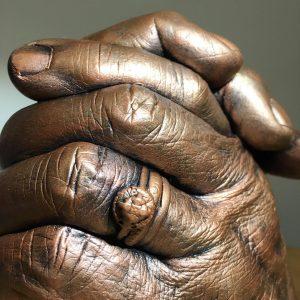 bronze effect hand clasp