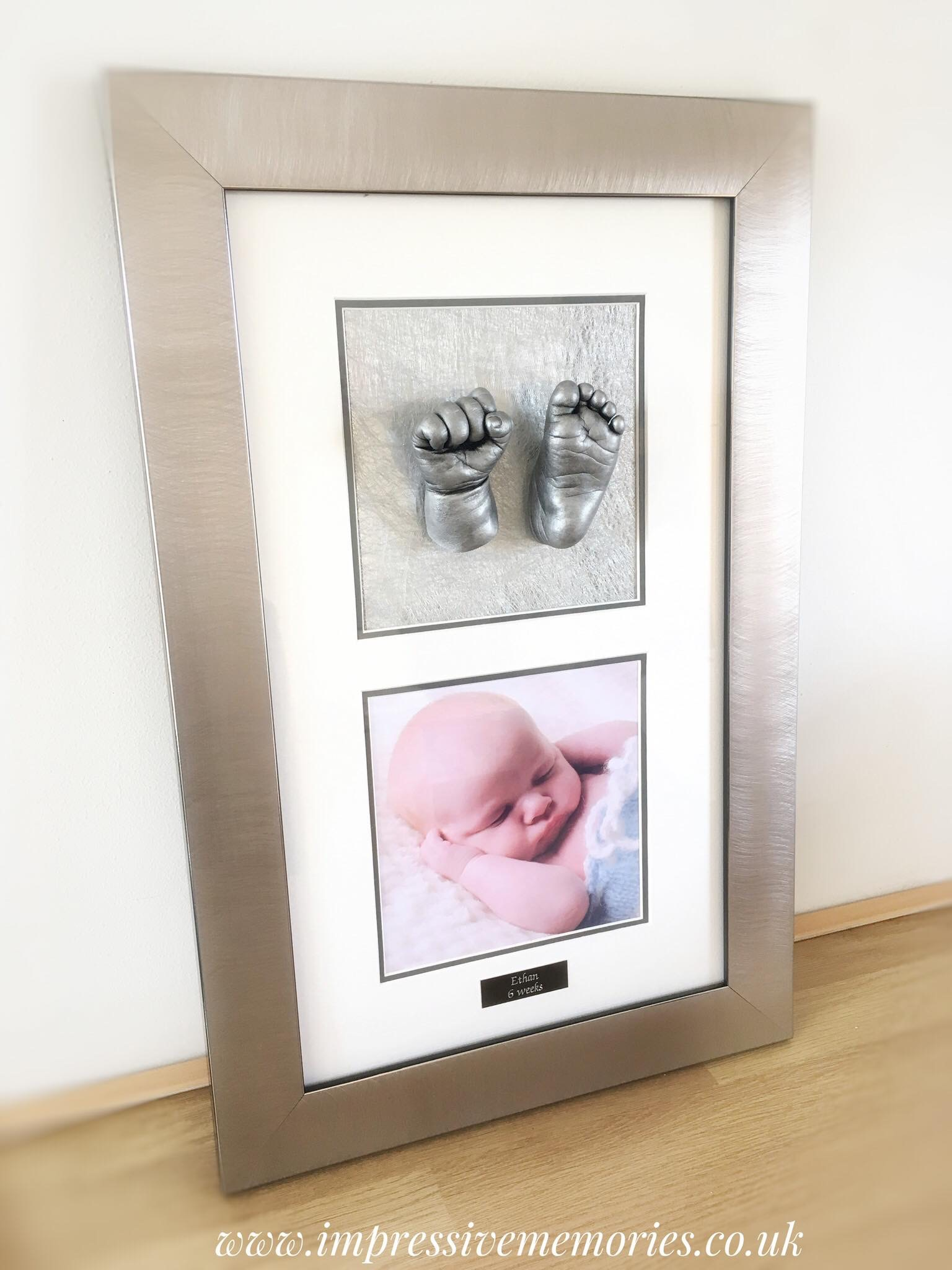 silver double aperture baby cast frame with two baby lifecasts