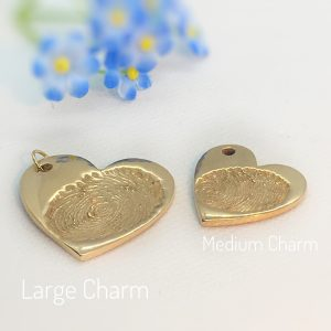 large golden ink print fingerprint charm