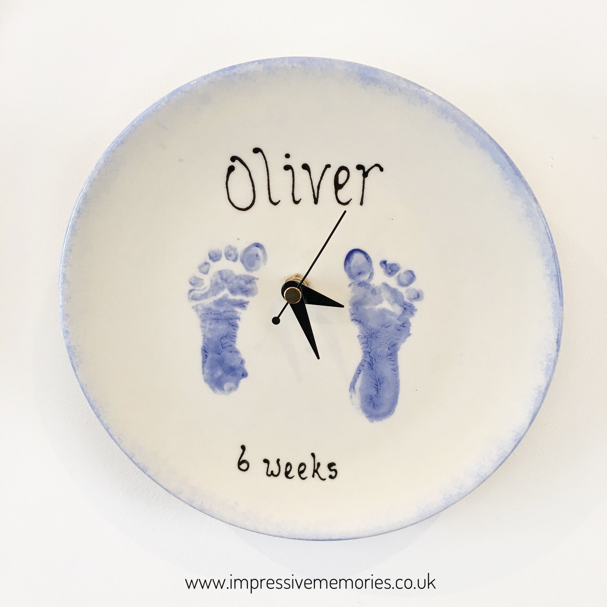 clay ceramics clock with baby hands and foot prints