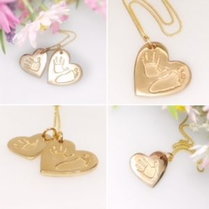 A handmade golden charm with an imprint of a childs hand or foot.