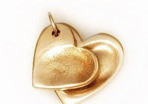 a double set golden fingerprint charms, shaped as hearts.